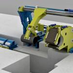 Impianto carico spool e macchina avvolgitrice nastro